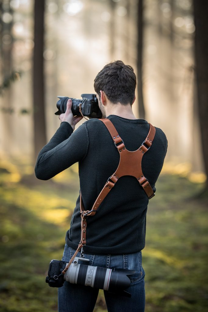 Dual camera harness in cognac with your own logo engraving to personalize your camera holster