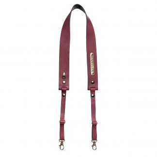 The Hantler's handmade bordeaux red leather neck strap wich can be personalized with your own name on the metal tag.