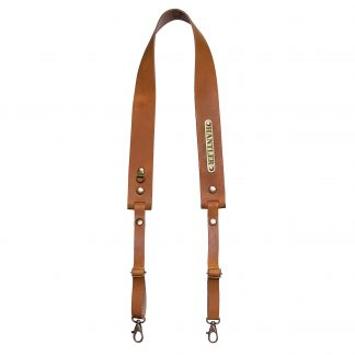 The Hantler's handmade cognac leather neck strap wich can be personalized with your own name on the metal tag.